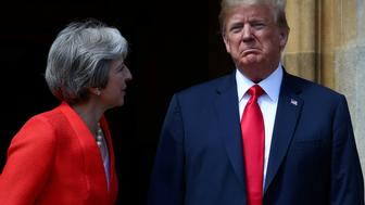 Britain's Prime Minister Theresa May poses for a photograph with U.S. President Donald Trump at Chequers near Aylesbury, Britain July 13, 2018. REUTERS/Hannah McKay     TPX IMAGES OF THE DAY