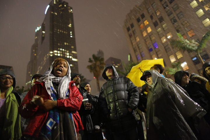 The author, Patrisse Cullors, speaks to people gathered to protest the Los Angeles Police shooting of a homeless man on