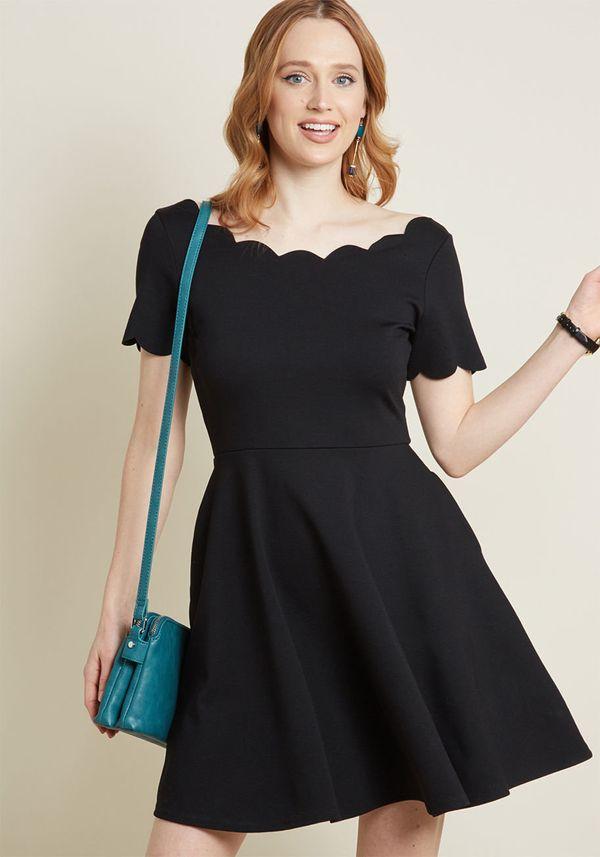 "<strong><a href=""https://www.modcloth.com/shop/dresses/smak-parlour-jukebox-jams-short-sleeve-dress-in-black/156907.html"" tar"