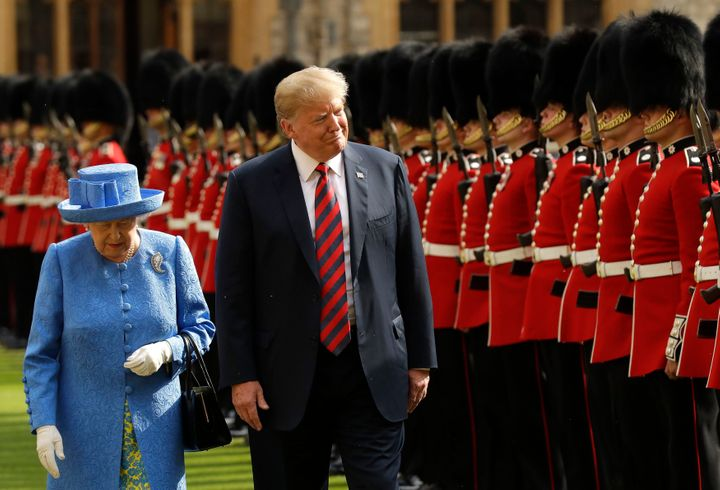 President Donald Trump and Queen Elizabeth II inspect a Guard of Honour, formed of the Coldstream Guards, at Windsor Castle o