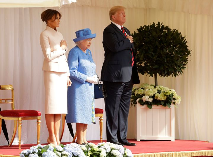 The Trumps stand alongside Queen Elizabeth II as they listen to the US national anthem at Windsor Castle.