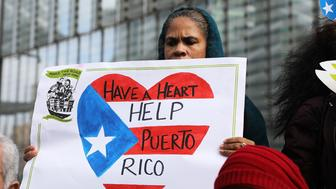 NEW YORK, NY - FEBRUARY 20:  Puerto Rican activists and others participate in a protest outside of New York City's Federal Emergency Management Agency (FEMA) office to call on Congress and FEMA to deliver the aid and resources thousands of Puerto Ricans desperately need to recover on February 20, 2018 in New York City. Nearly six months after Hurricane Maria delivered category 4 destruction to the U.S. territory of Puerto Rico,  thousands of island residents are still without running water or electricity.  (Photo by Spencer Platt/Getty Images)