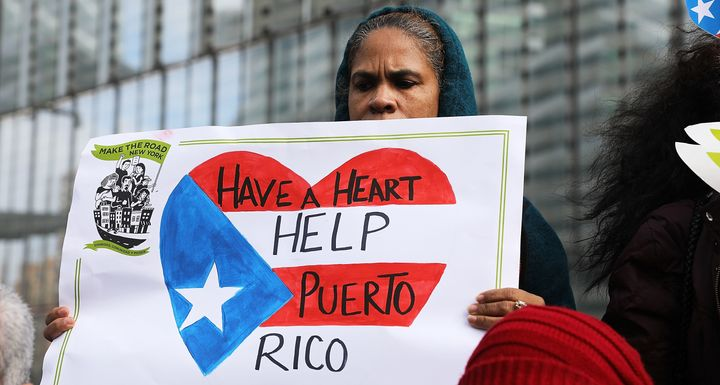Puerto Rican activists and others participate in a protest outside of New York City's FEMA office on Feb. 20.