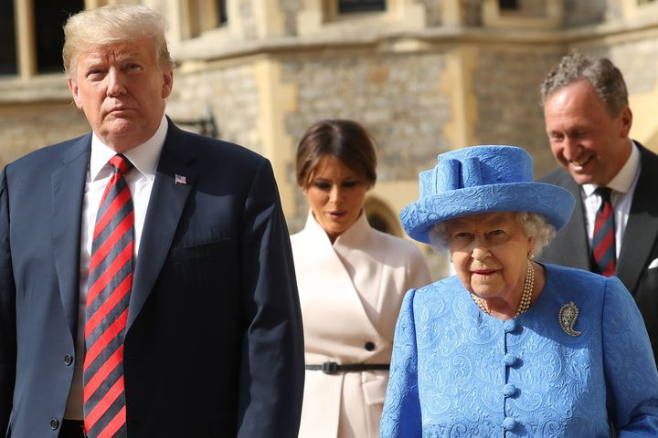 President Trump, Queen Elizabeth II, first lady Melania Trump and Lieutenant Colonel Sir Andrew Ford walk together to le