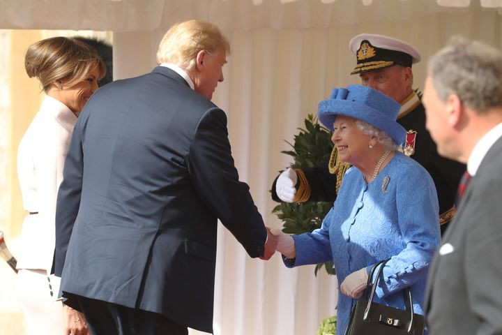President Donald Trump and first lady Melania Trump are greeted by the queen.