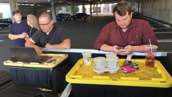 Capital Gazette reporter Chase Cook (R) and photographer Joshua McKerrow (L) work on the next days newspaper while awaiting news from their colleagues in Annapolis, Maryland, June 28, 2018. - At least five people were killed Thursday when a gunman opened fire inside the offices of the Capital Gazette, a newspaper published in Annapolis, a historic city an hour east of Washington.A reporter for the daily, Phil Davis, tweeted that a 'gunman shot through the glass door to the office and opened fire on multiple employees.''There is nothing more terrifying than hearing multiple people get shot while you're under your desk and then hear the gunman reload,' Davis said. (Photo by Ivan Couronne / AFP)        (Photo credit should read IVAN COURONNE/AFP/Getty Images)