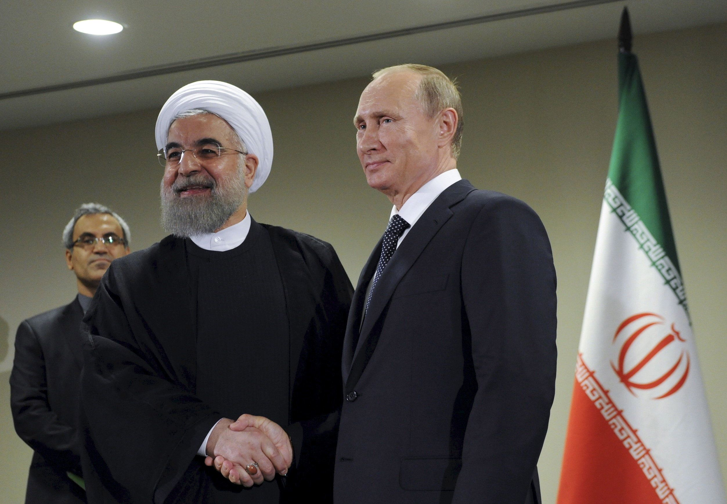 Russia's President Vladimir Putin (R) meets with Iran's President Hassan Rouhani on the sidelines of the United Nations General Assembly in New York, September 28, 2015. To match Insight RUSSIA-IRAN/    Mikhail Klimentyev/RIA Novosti/Kremlin/File Photo via REUTERS    ATTENTION EDITORS - THIS IMAGE WAS PROVIDED BY A THIRD PARTY. EDITORIAL USE ONLY.