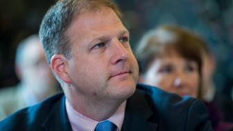 UNITED STATES - AUGUST 26: Councilor Chris Sununu listens during State of New Hampshire Executive Council meeting with Gov. Margaret 'Maggie' Hassan, D-N.H., at the Children's Museum of New Hampshire in Dover, N.H., on Wednesday, Aug. 26, 2015. (Photo By Bill Clark/CQ Roll Call)