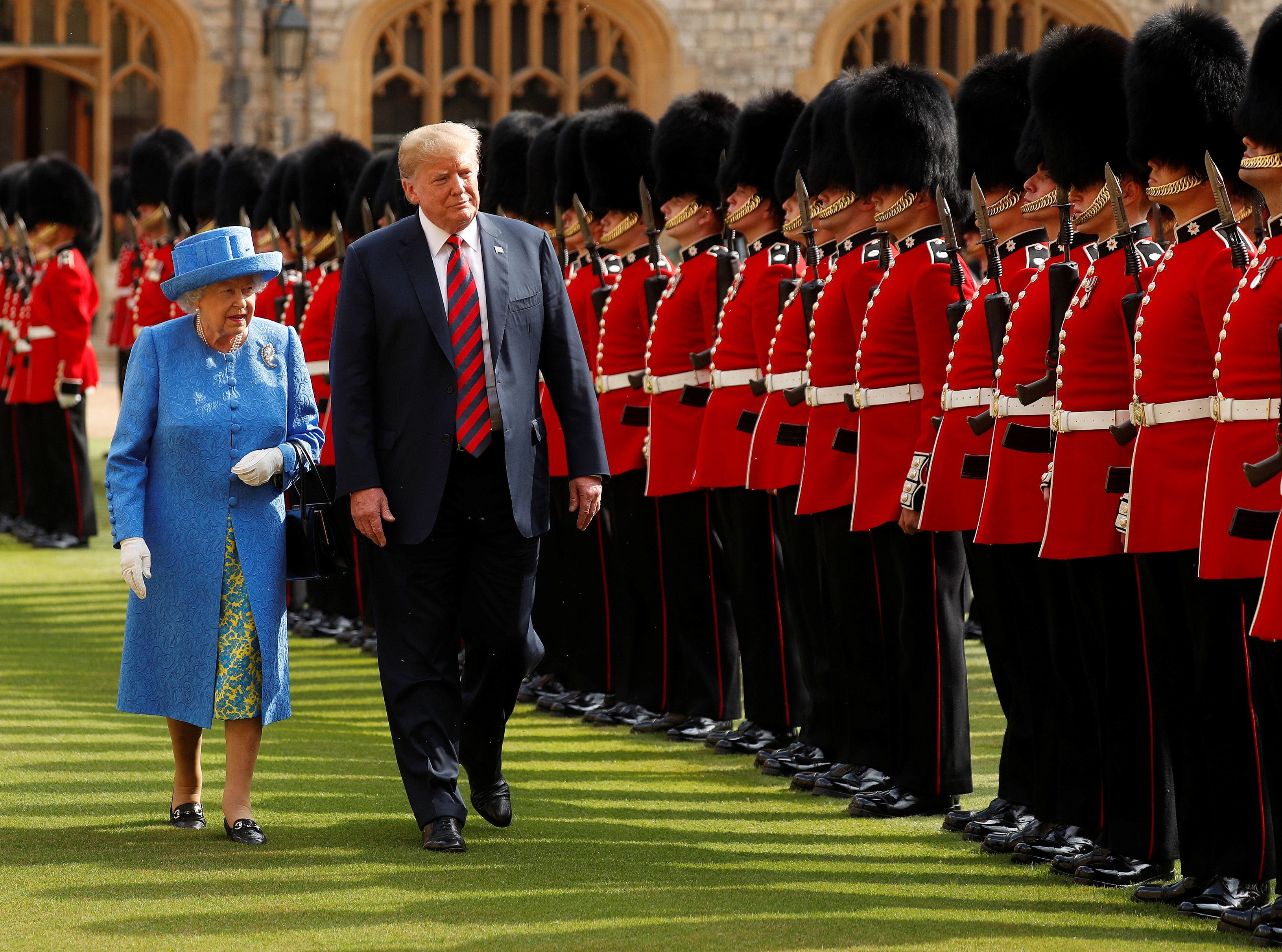 President Donald Trump and Britain's Queen Elizabeth inspect the Coldstream Guards during a visit Friday to Windsor Castle.