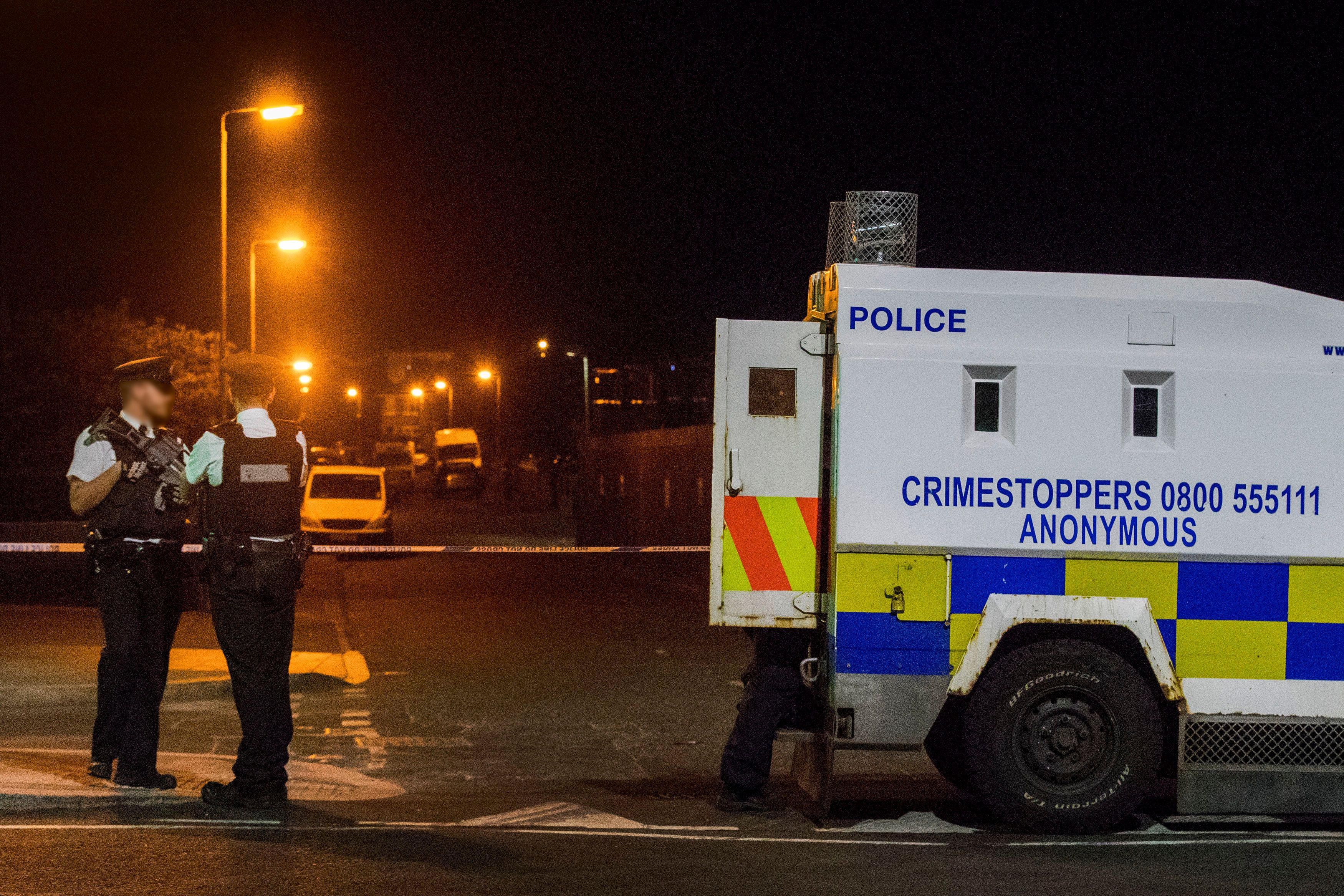 Police at the scene of an explosive device attack on the west Belfast home of Sinn Fein figure Bobby