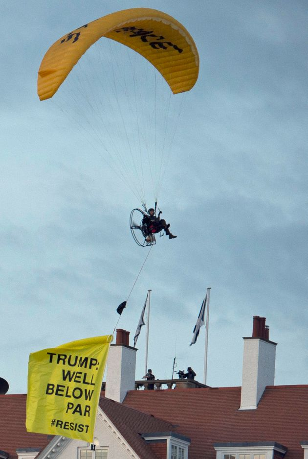 The Greenpeace protester flies a