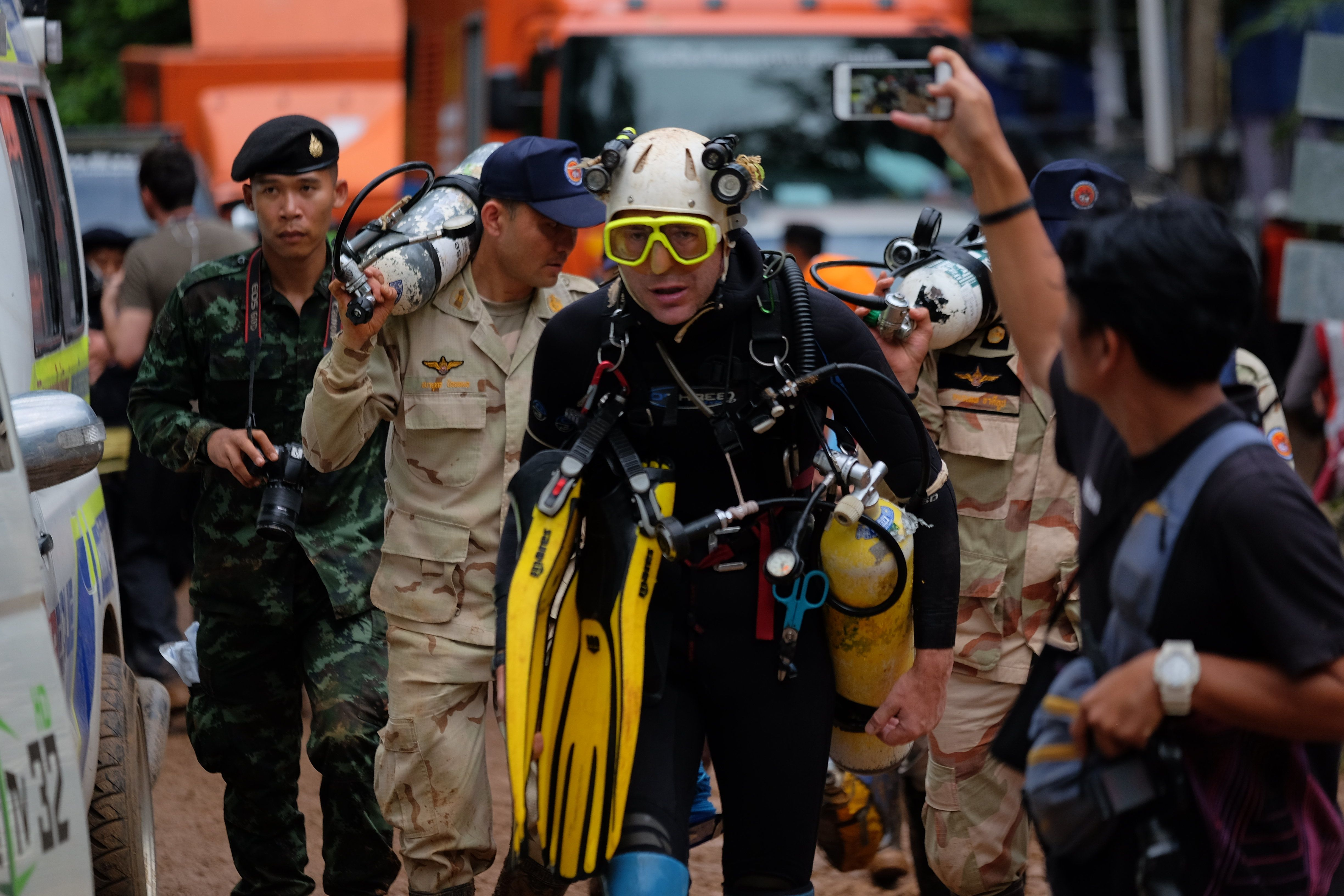 British cave-diver John Volanthen walks out from theLuang Nang Non Cave in northern Thailand during the rescue mission to free a football team and their coach