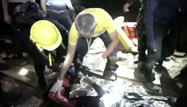 Footage showing one of the young boys being rescued from the caves