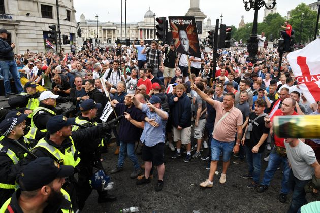 Demonstrators clash with police during an earlier Free Tommy Robinson rally in London on June 9