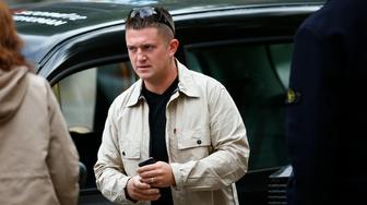English Defence League leader Tommy Robinson arrives at Westminster Magistrates' Court in London September 11, 2013. Robinson is charged under his real name Stephen Yaxley-Lennon, with obstructing police during an attempt to walk to Woolwich Barracks following the killing of Drummer Lee Rigby. REUTERS/Andrew Winning  (BRITAIN)