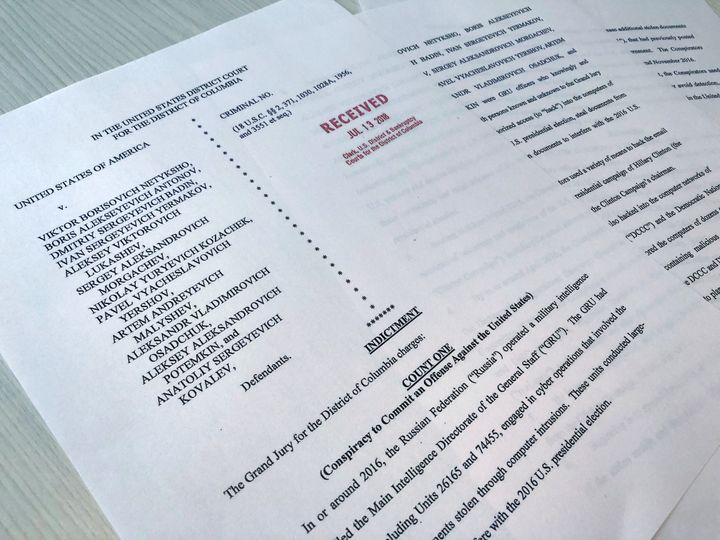 A copy of the grand jury indictment against 12 Russian intelligence officers is seen after being filed by prosecutors fo