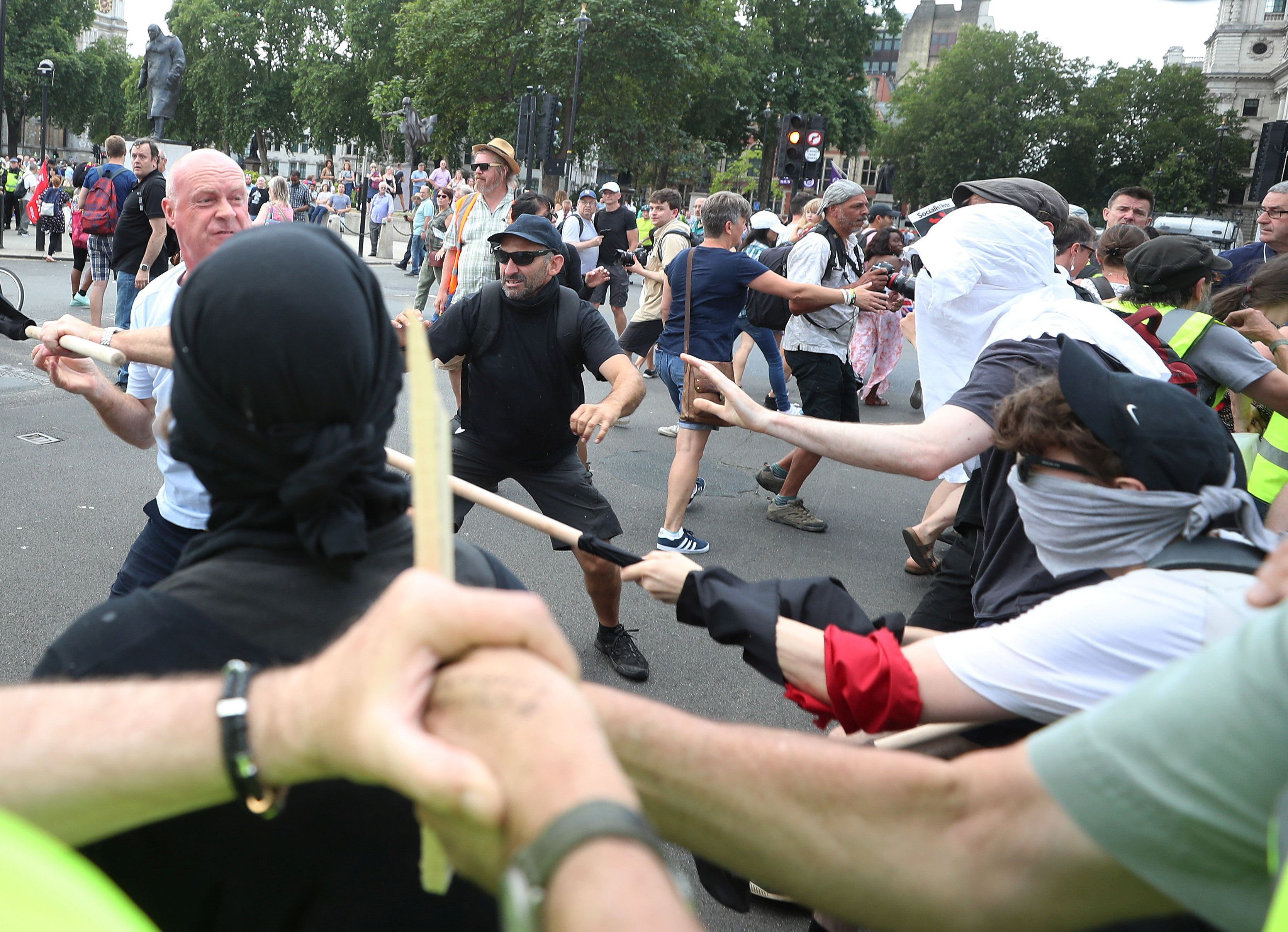 Union Leader Assaulted As Pro And Anti-Tommy Robinson Marches Clash In