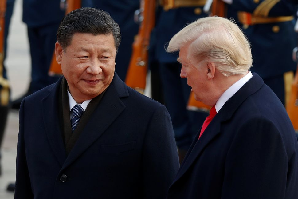 U.S. President Donald Trump takes part in a welcoming ceremony with China's President Xi Jinping.