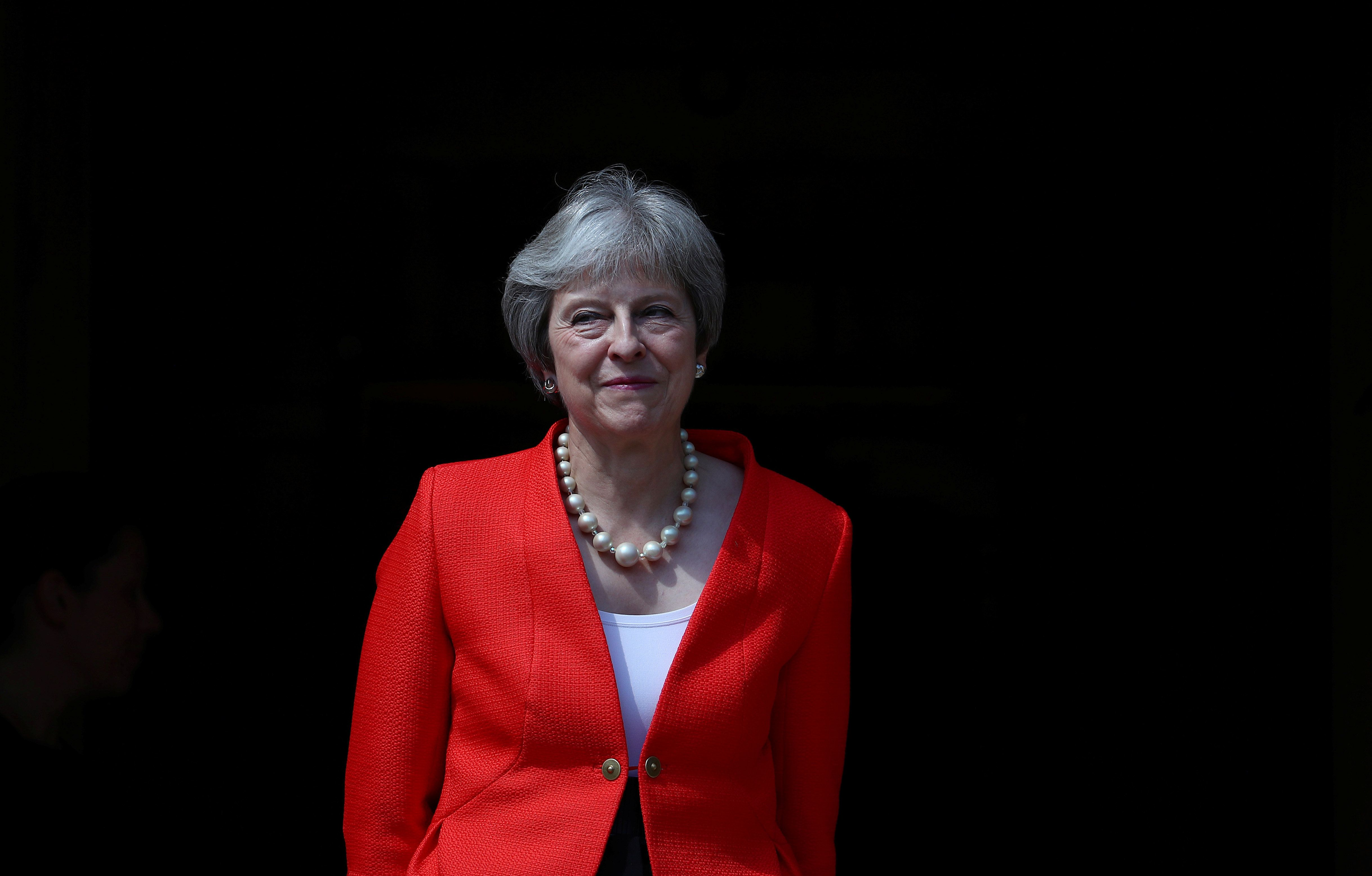 Britain's Prime Minister Theresa May greets U.S. President Donald Trump at Chequers.
