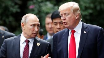 U.S. President Donald Trump and Russia's President Vladimir Putin talk during the family photo session at the APEC Summit in Danang, Vietnam November 11, 2017. REUTERS/Jorge Silva