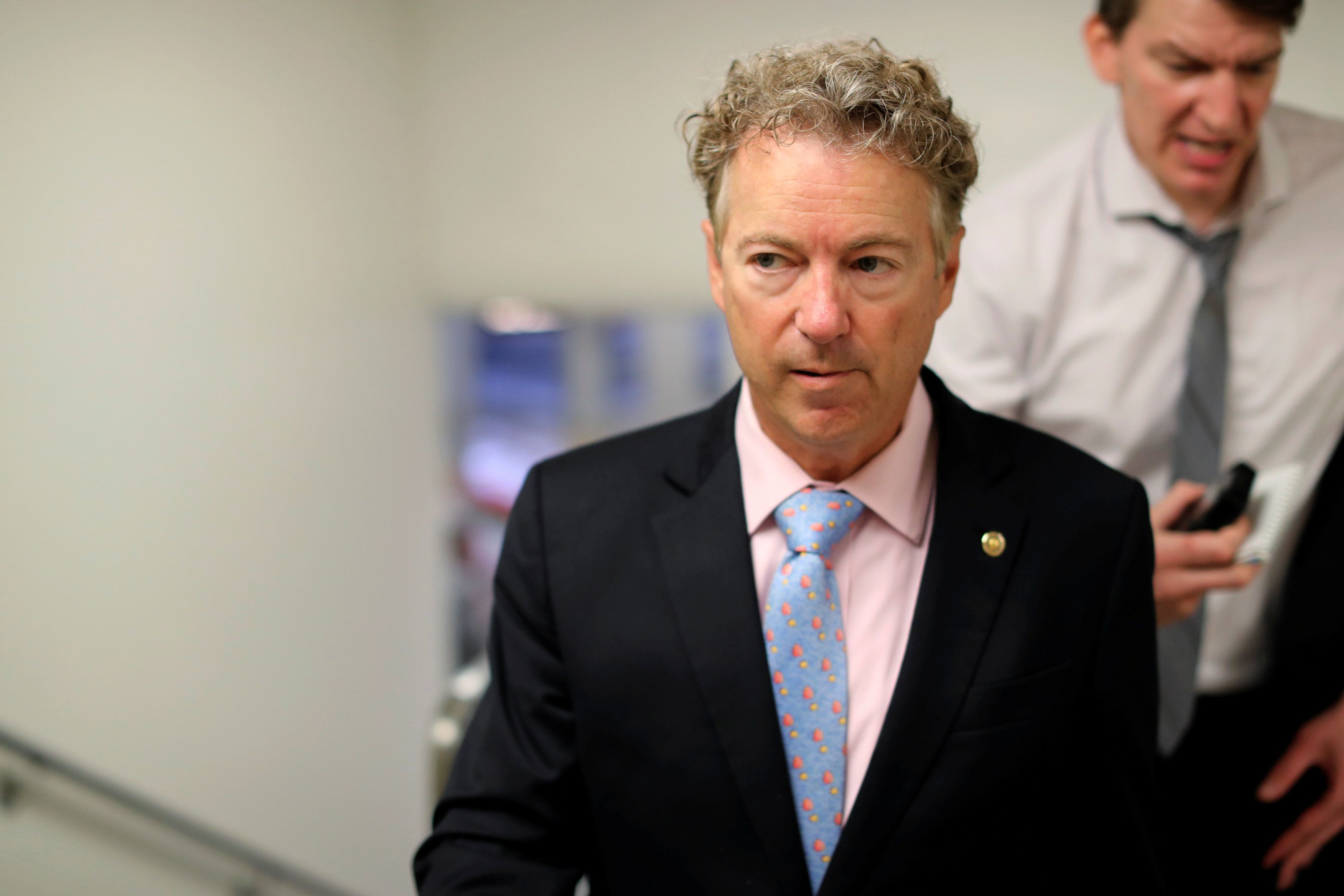 U.S. Senator Rand Paul (R-KY) is trailed by reporters as he arrives for the weekly Senate Republican caucus luncheon at the U.S. Capitol in Washington, U.S., May 22, 2018.  REUTERS/Jonathan Ernst