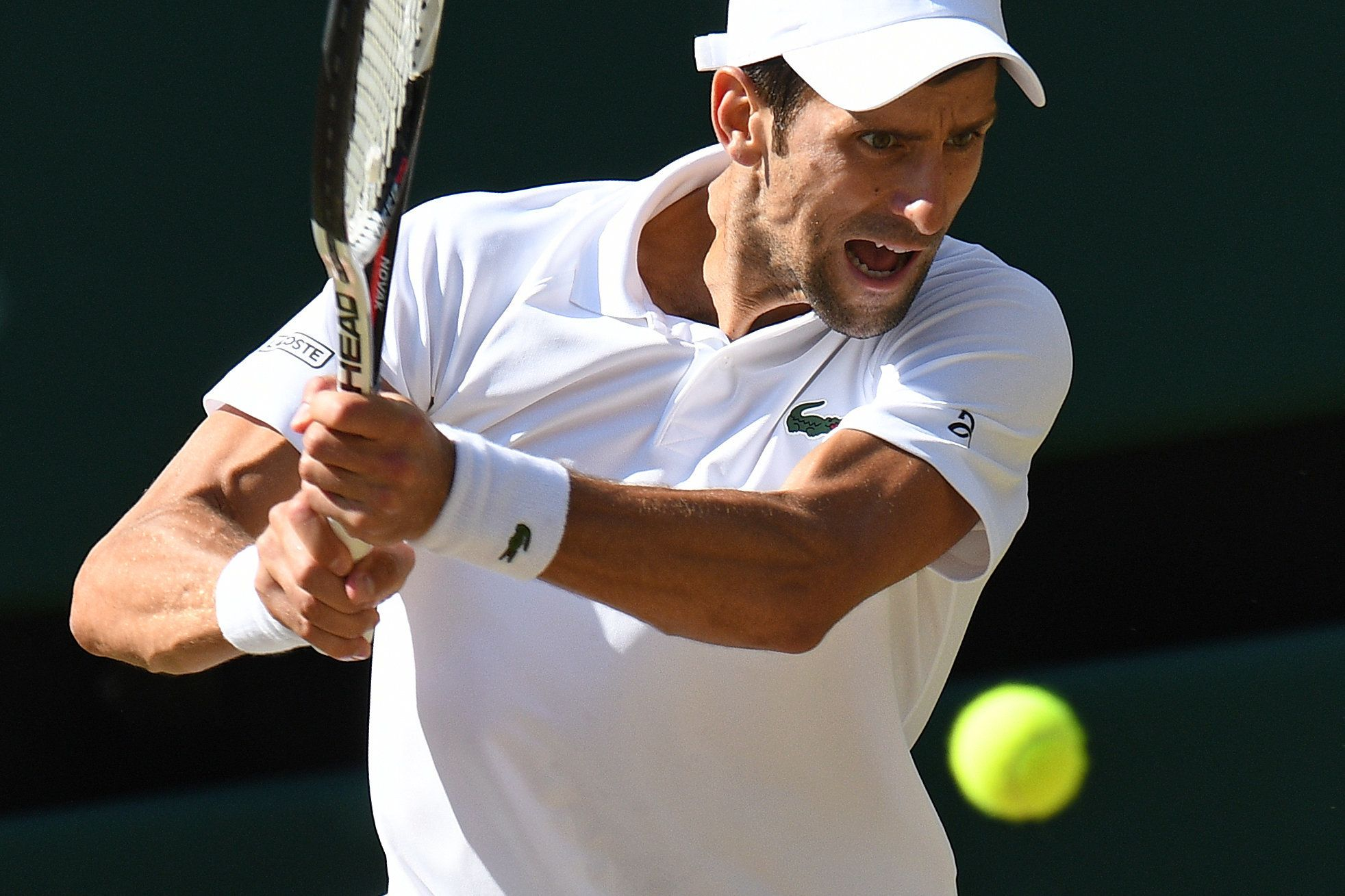 Serbia's Novak Djokovic returns to South Africa's Kevin Anderson in their men's singles final match on the thirteenth day of the 2018 Wimbledon Championships at The All England Lawn Tennis Club in Wimbledon, southwest London, on July 15, 2018. (Photo by Oli SCARFF / AFP) / RESTRICTED TO EDITORIAL USE        (Photo credit should read OLI SCARFF/AFP/Getty Images)