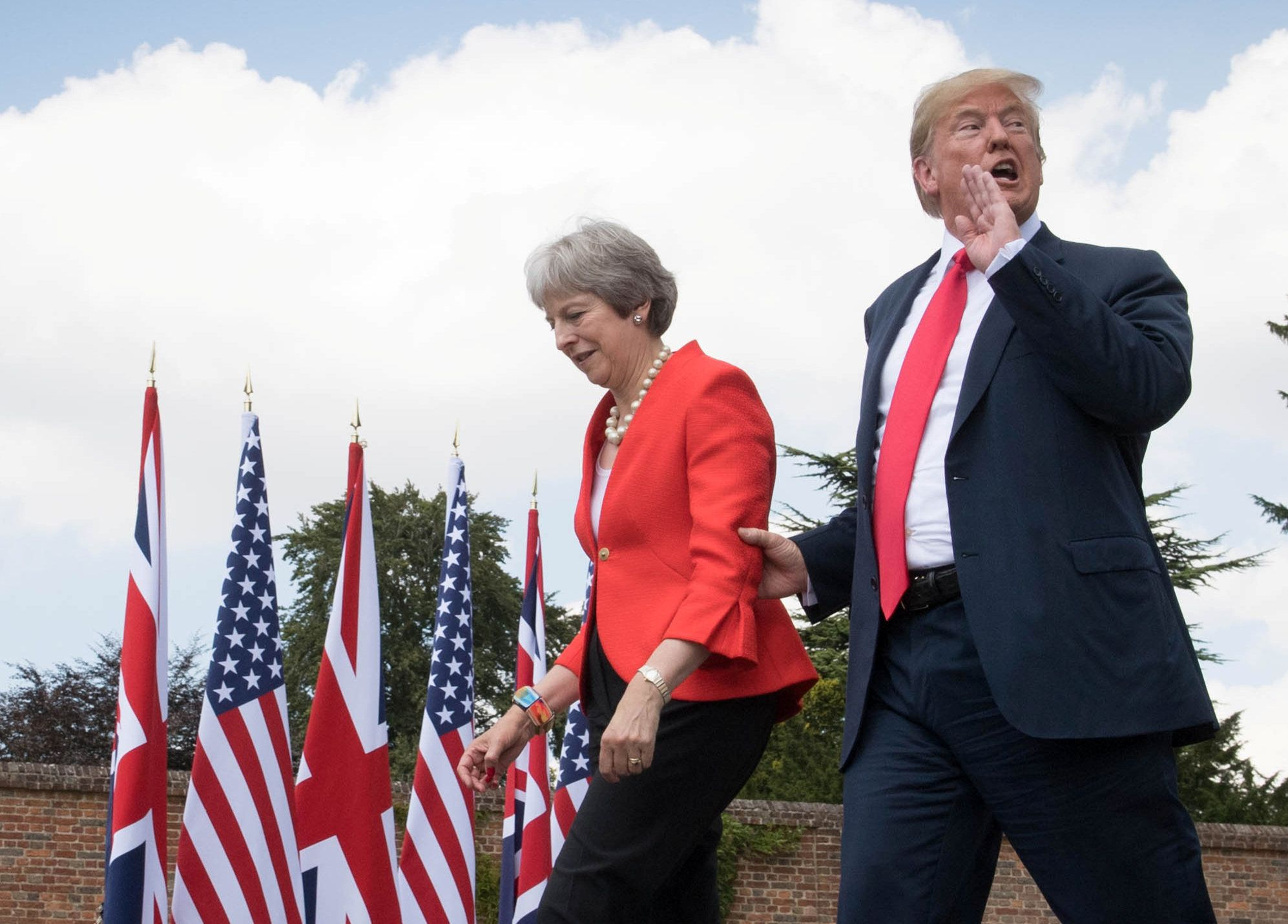 U.S. President Donald Trump walks with Britain's Prime Minister Theresa May prior to a joint press conference at Chequers, near Aylesbury, Britain July 13, 2018. Stefan Rousseau/Pool via REUTERS