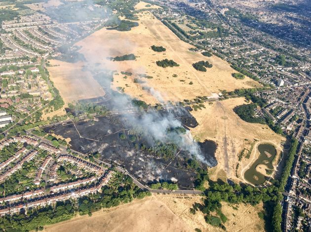Images from a police helicopter showing smoke rising from the scorched Wanstead Flats in east London.