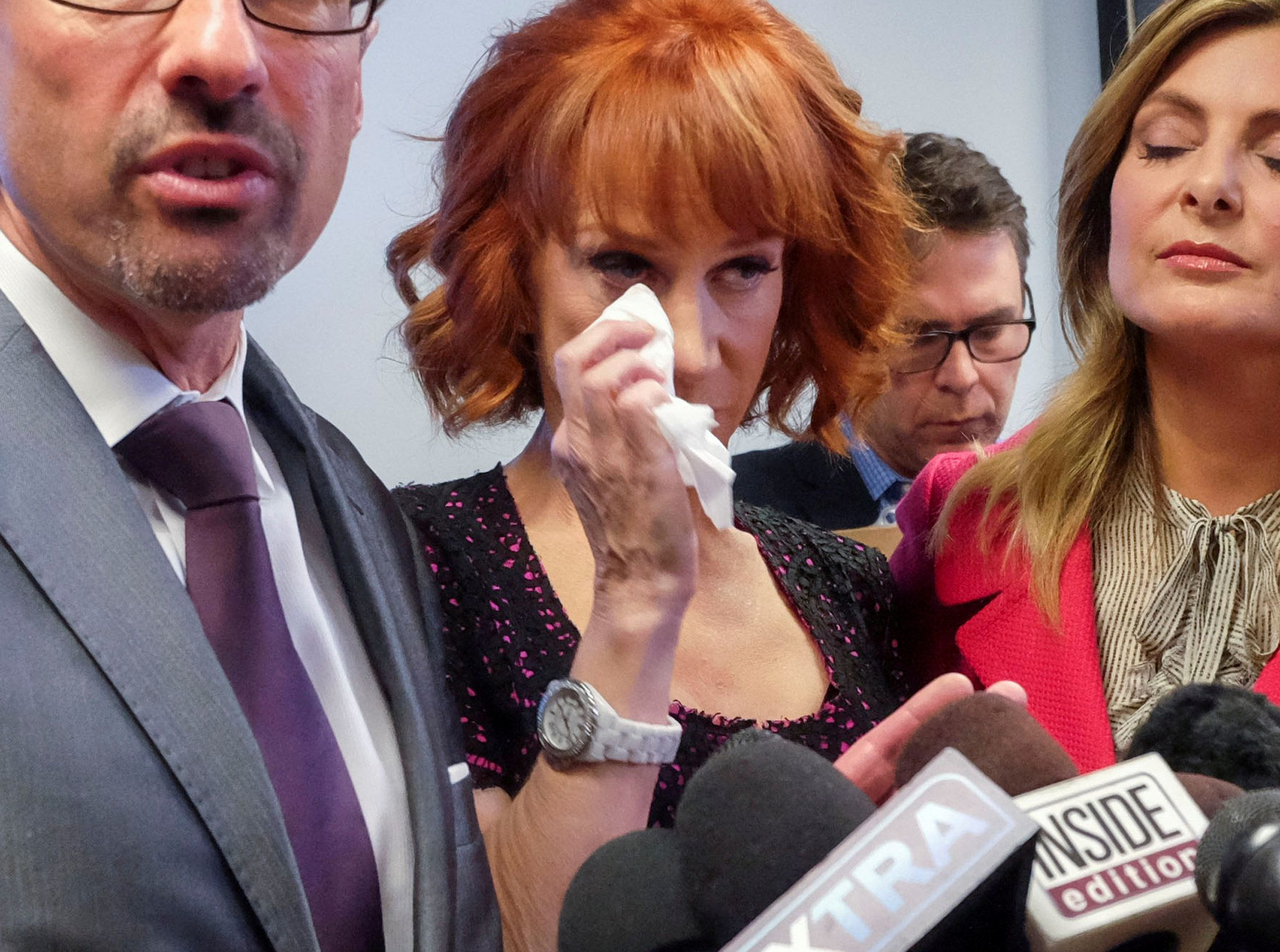 Comedian Kathy Griffin wipes her eyes as her criminal attorney Dmitry Gorin (L) speaks at a news conference in Woodland Hills, Los Angeles, California, U.S., June 2, 2017. At right is attorney Lisa Bloom. REUTERS/Ringo Chiu