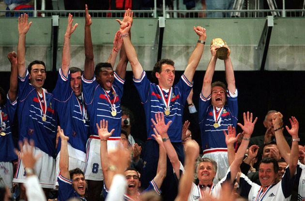 France players celebrate in 1998 as then captain Didier Deschamps, now the manager of the national team,...
