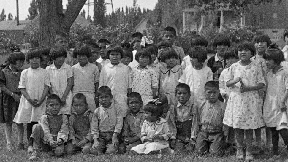 A group of Navajo children photographed in 1929. They were removed from their homes and placed into a government-run boa