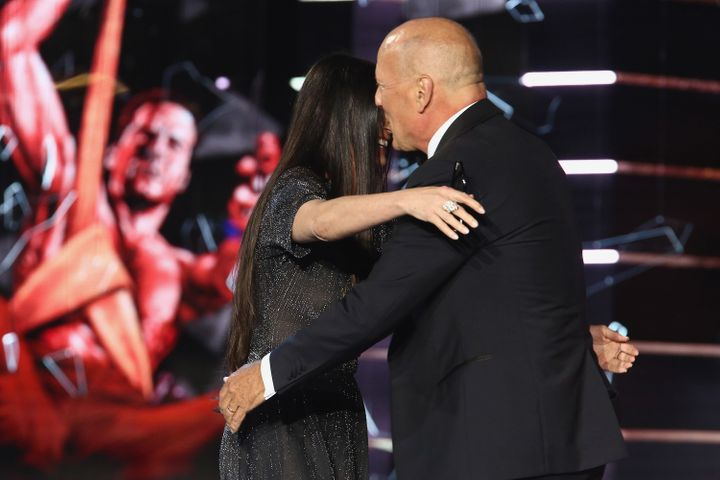 Moore and Willis hug it out after she ribbed him at his Comedy Central roast.