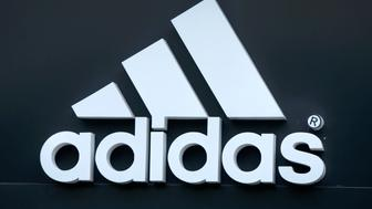 The logo of Adidas is seen on a store in Yerevan, Armenia, June 23, 2016. REUTERS/David Mdzinarishvili/File Photo