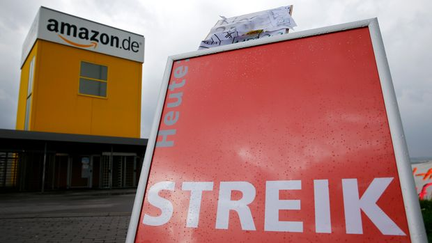 A Verdi union placard reading 'strike' stands outside the Amazon.de distribution centre in Bad Hersfeld September 22, 2014. Workers at German warehouses of online retailer Amazon.com  took strike action again on Monday as labour union Verdi pressed its demands in a long-running dispute over pay and conditions. The U.S. company employs a total of 9,000 warehouse staff at nine distribution centres in Germany, its second-biggest market behind the United States, plus 14,000 seasonal workers.    REUTERS/Kai Pfaffenbach (GERMANY  - Tags: BUSINESS EMPLOYMENT CIVIL UNREST TPX IMAGES OF THE DAY)
