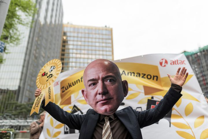 A demonstrator in Berlin marches during an April protest against Amazon CEO Jeff Bezos.