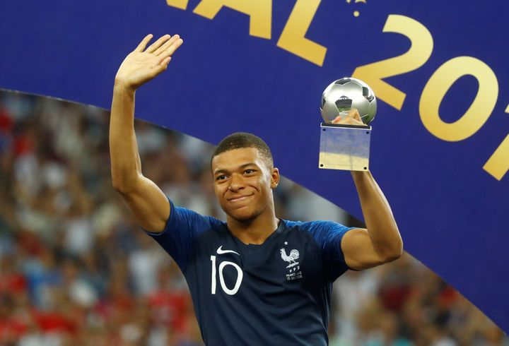 Mbappé, 19, receives the FIFA Young Player award following France's World Cup victory.