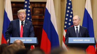 U.S. President Donald Trump, left, speaks, as Vladimir Putin, Russia's President, pauses during a news conference in Helsinki, Finland, on Monday, July 16, 2018. Trump said a two-hour, one-on-one meeting with Putin was a good start on Monday for their Helsinki summit, but gave no indication he had relented to increased pressure to confront the Kremlin leader over election meddling. Photographer: Chris Ratcliffe/Bloomberg via Getty Images