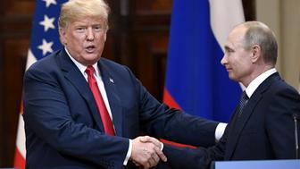 U.S. President Donald Trump and Russia's President Vladimir Putin shake hands after their joint news conference in the Presidential Palace in Helsinki, Finland July 16, 2018. Lehtikuva/Antti Aimo-Koivisto via REUTERS ATTENTION EDITORS - THIS IMAGE WAS PROVIDED BY A THRID PARTY. FINLAND OUT. NO THIRD PARTY SALES.