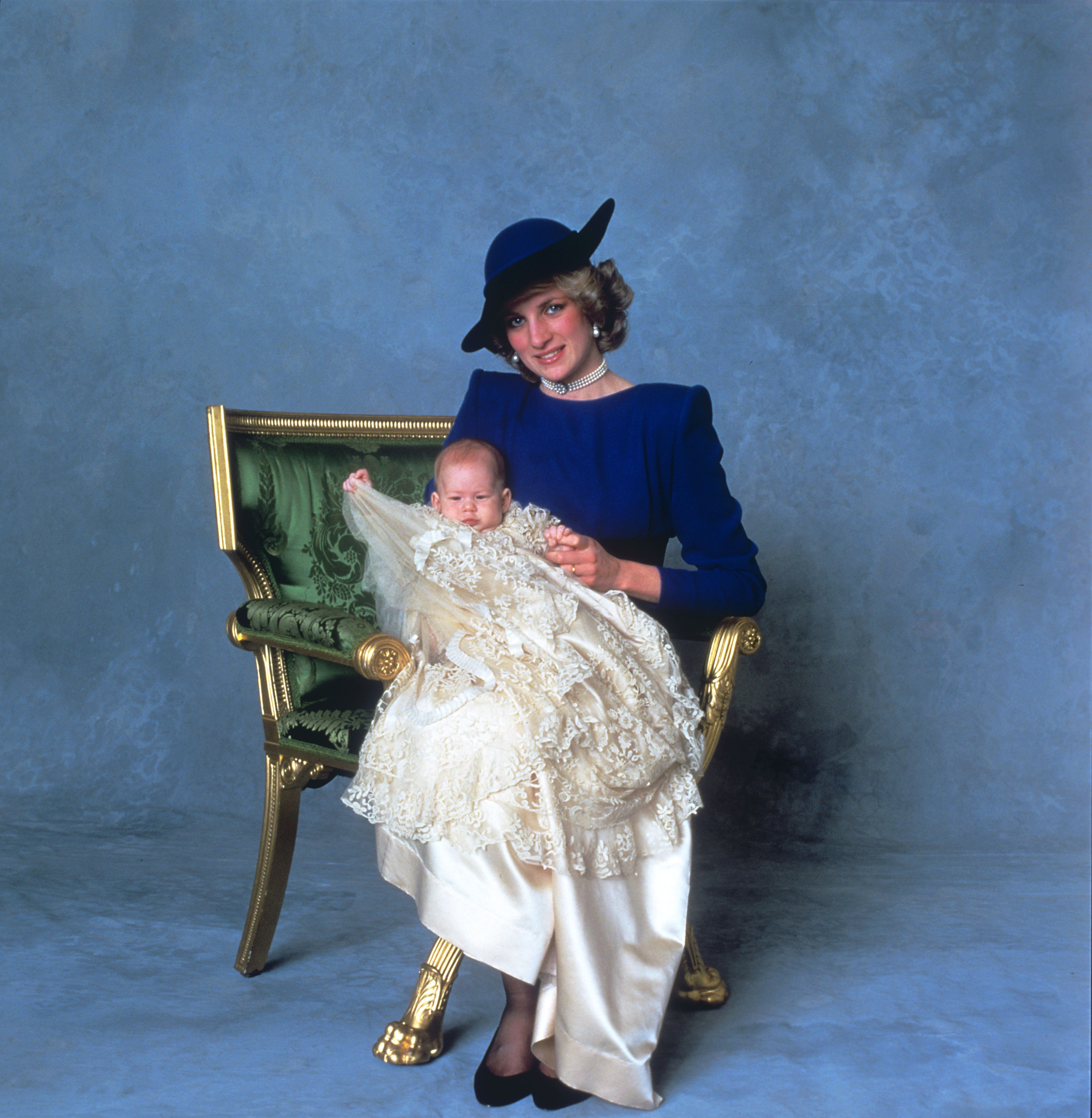 Princess Diana holds Prince Harry onthe day of his christeningonDec. 21, 1984.