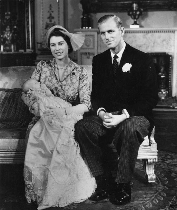 Then-Princess Elizabeth holding Princess Anne alongsidethe Duke of Edinburghon her christening day at Buckingham