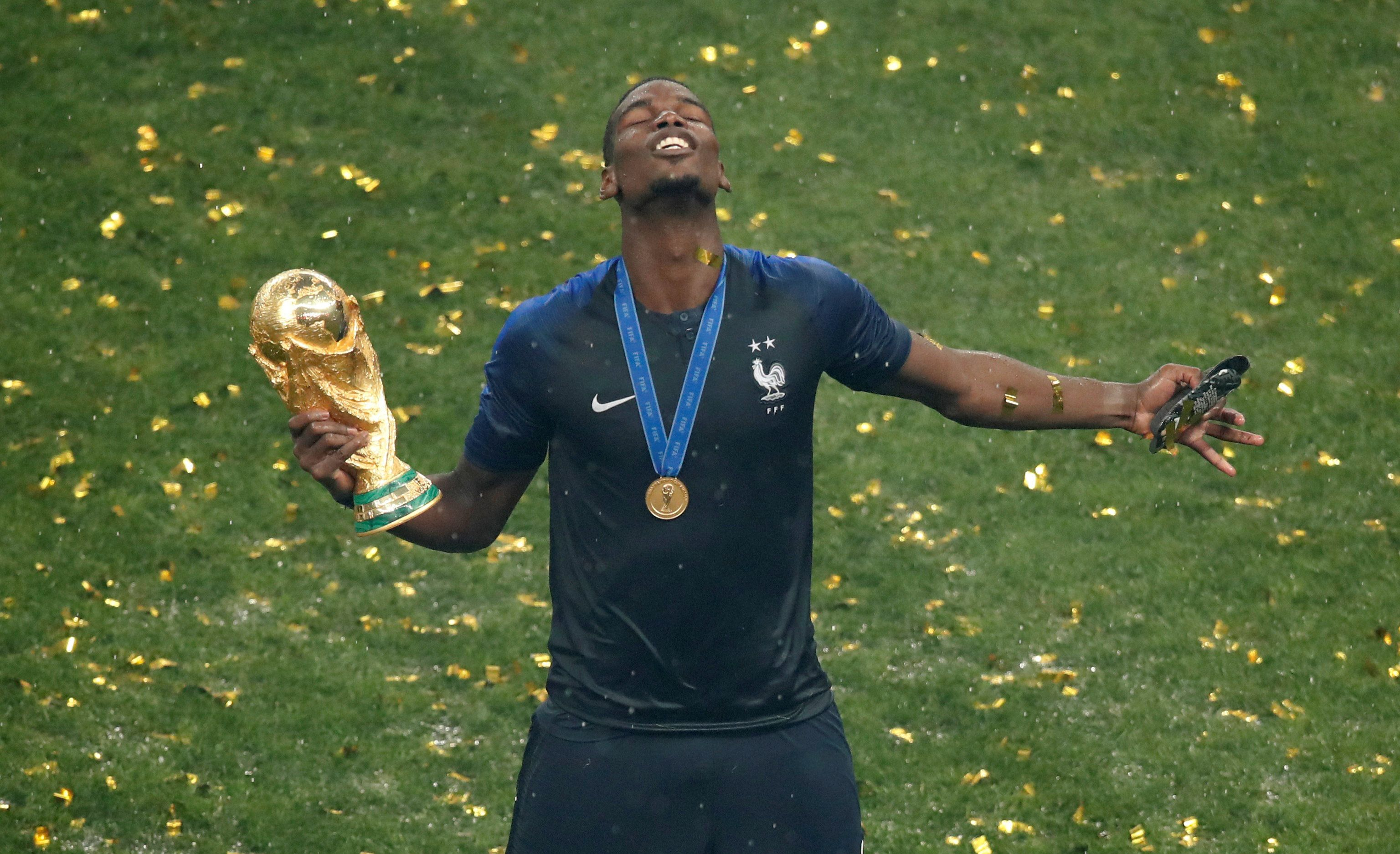 Soccer Football - World Cup - Final - France v Croatia - Luzhniki Stadium, Moscow, Russia - July 15, 2018  France's Paul Pogba holds the trophy as they celebrate winning the World Cup  REUTERS/Christian Hartmann