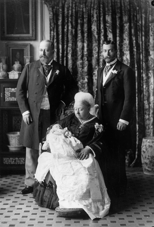 Queen Victoria holdingthe future King Edward VIII on the day of his christening in 1894. His father (later George V) an