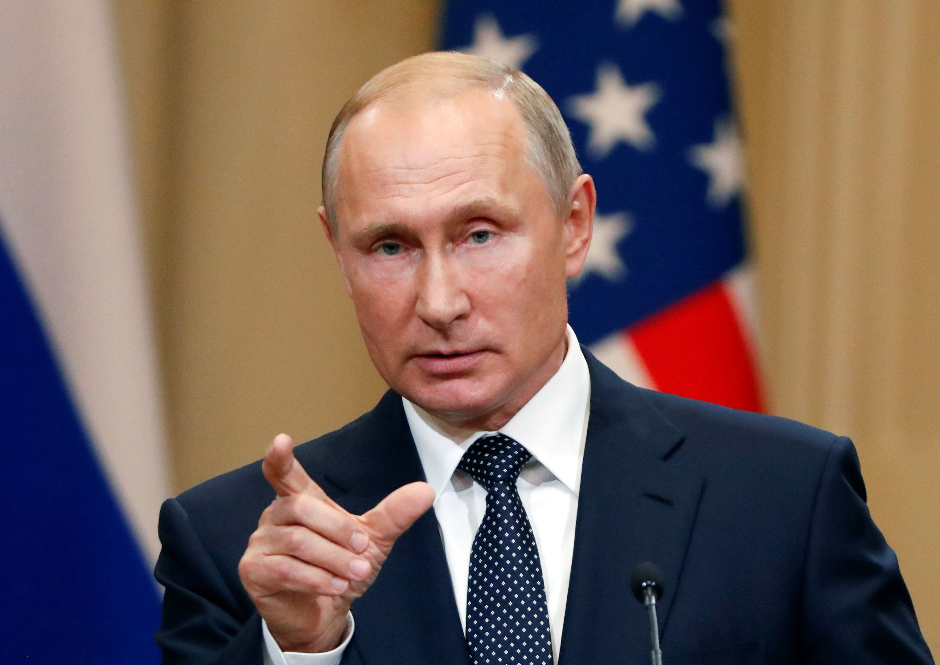 Russian President Vladimir Putin gestures during a joint news conference with U.S. President Donald Trump (not pictured) after their meeting in Helsinki, Finland July 16, 2018. REUTERS/Grigory Dukor