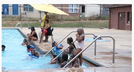 Children swim at the Foster Brown public pool in Wilmington, July 12. Mayor Mike Purzycki said in a statement that