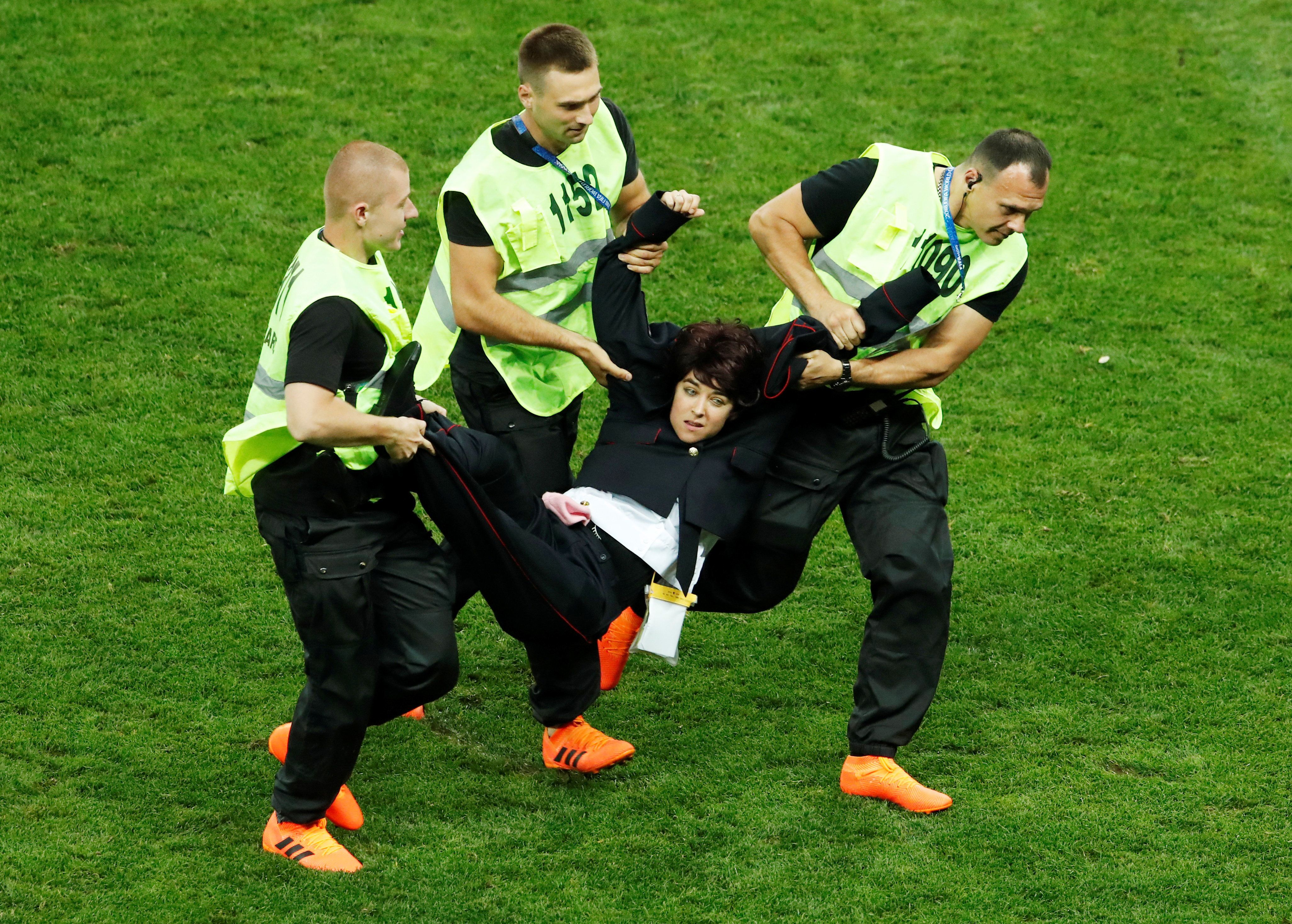 Soccer Football - World Cup - Final - France v Croatia - Luzhniki Stadium, Moscow, Russia - July 15, 2018  Stewards apprehend a pitch invader   REUTERS/Maxim Shemetov