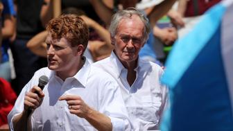 BOSTON, MA - JUNE 30: U.S. Congressman Joe Kennedy, left, and U.S. Senator Edward Markey speak to demonstrators during the Together and Free Rally Against Family Separation at City Hall Plaza in Boston on June 30, 2018. Thousands of demonstrators marched from City Hall Plaza to Boston Common as part of a national wave of protests incited by current U.S. immigration policies. (Photo by Craig F. Walker/The Boston Globe via Getty Images)
