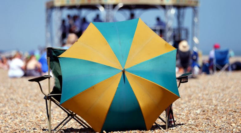 British Woman, 67, Impaled By Beach Umbrella After 'Strong Gust Of