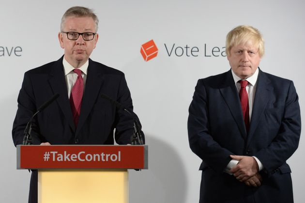 Michael Gove MP (L) speaks during a press conference as Boris Johnson MP looks on following the results...