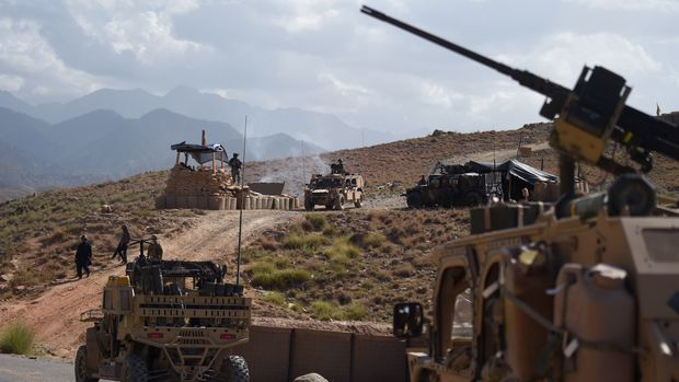 In this photo taken on July 7, 2018, US Army from NATO and Afghan commando forces are pictures in a checkpoint during a patrol against Islamic State militants at the Deh Bala district in the eastern province of Nangarhar Province. - A US soldier was killed and two others wounded in an 'apparent insider attack' in southern Afghanistan on July 8, NATO said, the first such killing in nearly a year. (Photo by WAKIL KOHSAR / AFP)        (Photo credit should read WAKIL KOHSAR/AFP/Getty Images)