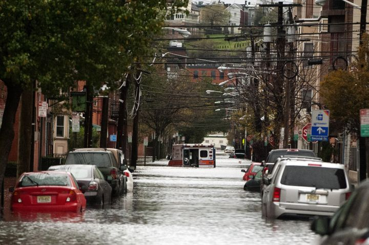 An ambulance sits abandoned in the middle of a flooded street afterSuperstorm Sandy on Oct. 30, 2012, in Hoboken, New J